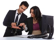 Businesscouple solving a problem near a computer Royalty Free Stock Photos