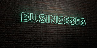 BUSINESSES -Realistic Neon Sign on Brick Wall background - 3D rendered royalty free stock image. Can be used for online banner ads and direct mailers Royalty Free Stock Image