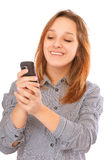 Businessgirl sending a text message with her phone Royalty Free Stock Image