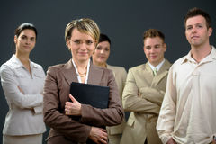 Businessgroup. Businesswoman standing in front of his smiling team Stock Image