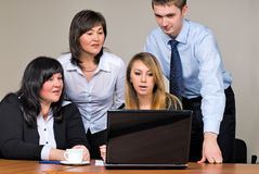 Businessgroup with laptop. Business team at meeting led by the businessman Royalty Free Stock Images