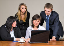 Businessgroup with laptop. Business team at meeting led by the businessman Stock Photos