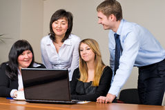 Businessgroup with laptop. Business team at meeting led by the businessman Royalty Free Stock Image
