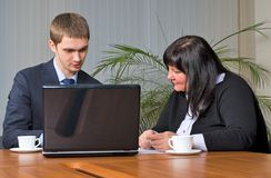 Businessgroup with laptop. Business team at meeting led by the businessman Stock Photo