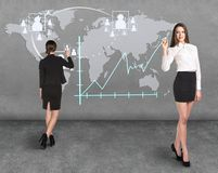 Businessladies in front of the map Stock Photography