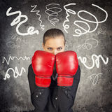 Businesslady in boxing gloves Royalty Free Stock Images