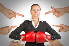 Businesslady in boxing gloves Royalty Free Stock Image