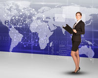 Businesslady with folder and world map Stock Photo