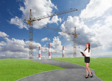 Businesslady in front of a factory Stock Photo