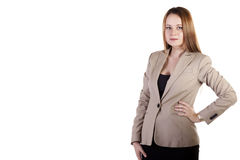 Businesslady with hands ar her hips isolated on white with copys Stock Photo