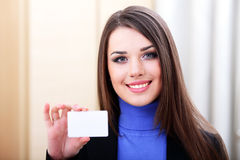 Businesslady holding a blank card Stock Photography