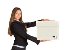 Businesslady holding box and looking at camera Royalty Free Stock Images