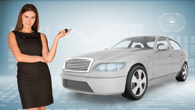 Businesslady holding car key Royalty Free Stock Images