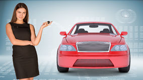 Businesslady holding car key Royalty Free Stock Photography