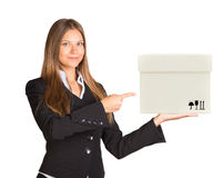 Businesslady holding and pointing at box Royalty Free Stock Image