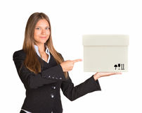 Businesslady holding and pointing at white box Stock Photos