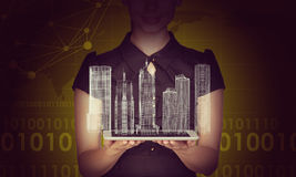 Businesslady holding tablet and 3d city model Royalty Free Stock Images