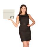 Businesslady holding white box Royalty Free Stock Image