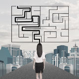 Businesslady with labyrinth Stock Images