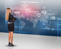 Businesslady looking at camera, rear view Stock Images