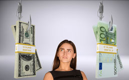 Businesslady looking at money Royalty Free Stock Images