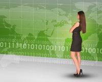Businesslady looking at world map Royalty Free Stock Photos