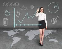 Businesslady on the map Stock Images