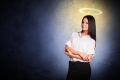 Businesslady with nimbus Stock Image