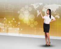 Businesslady pointing at map Royalty Free Stock Photography