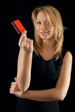 Businesslady presenting company's card Stock Images