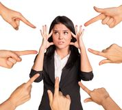 Businesslady showing emotions. And set of hands pointing at her on isolated white background Stock Photography