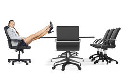 Businesslady sitting in chair with her crossed Royalty Free Stock Image