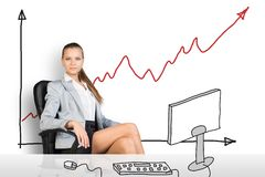 Businesslady sitting half-turned at drawn table Stock Image