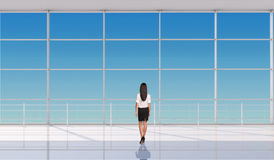 Businesslady standing back Royalty Free Stock Images