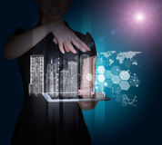 Businesslady with tablet and 3d city model. On abstract blue background Royalty Free Stock Photos