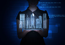 Businesslady with tablet and 3d city model. On abstract blue background Stock Photography