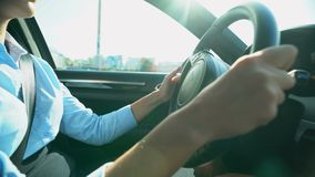 Businesslady turning steering wheel, driving to office, careful driver in city. Stock footage stock footage