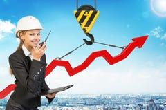 Businesslady with walkie-talkie set Stock Photo
