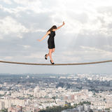 Businesslady walking on rope Royalty Free Stock Photo