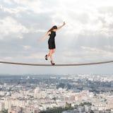 Businesslady walking on rope Royalty Free Stock Photo