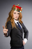 Businesslady wearing crown against gray Stock Images