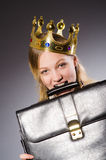 Businesslady wearing crown against gray Stock Image