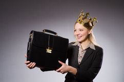 Businesslady wearing crown against gray Royalty Free Stock Photos