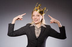 Businesslady wearing crown against gray Royalty Free Stock Photography