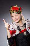 Businesslady wearing crown against gray Stock Photo