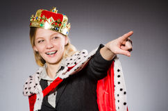 Businesslady wearing crown against gray Royalty Free Stock Photo