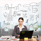 Businesslady working on laptop in an office Royalty Free Stock Photo