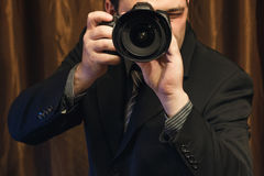 Businesslike Photographer. Shoots Portrait Close Up Royalty Free Stock Photography
