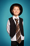 Businesslike. Portrait of a cute smiling boy wearing suit and tie. Studio shot Royalty Free Stock Photography