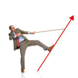 Businessm and rising arrow. Businessman retain a rising arrow, representing business growth stock photography